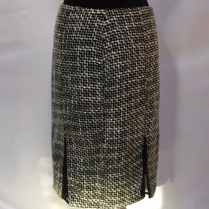 Tweed mid length skirt with kick slits